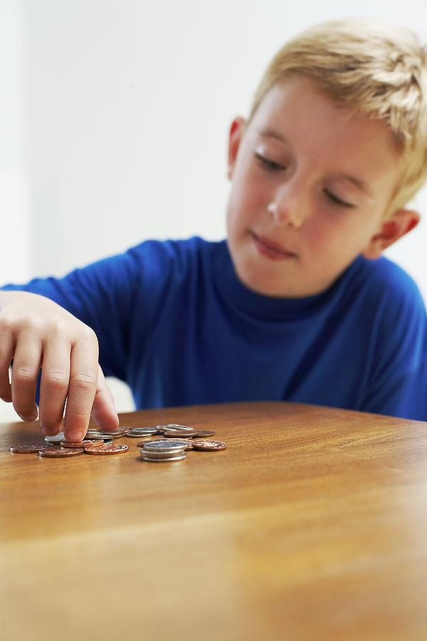 Money Photograph - Child With Loose Change by Ian Boddy