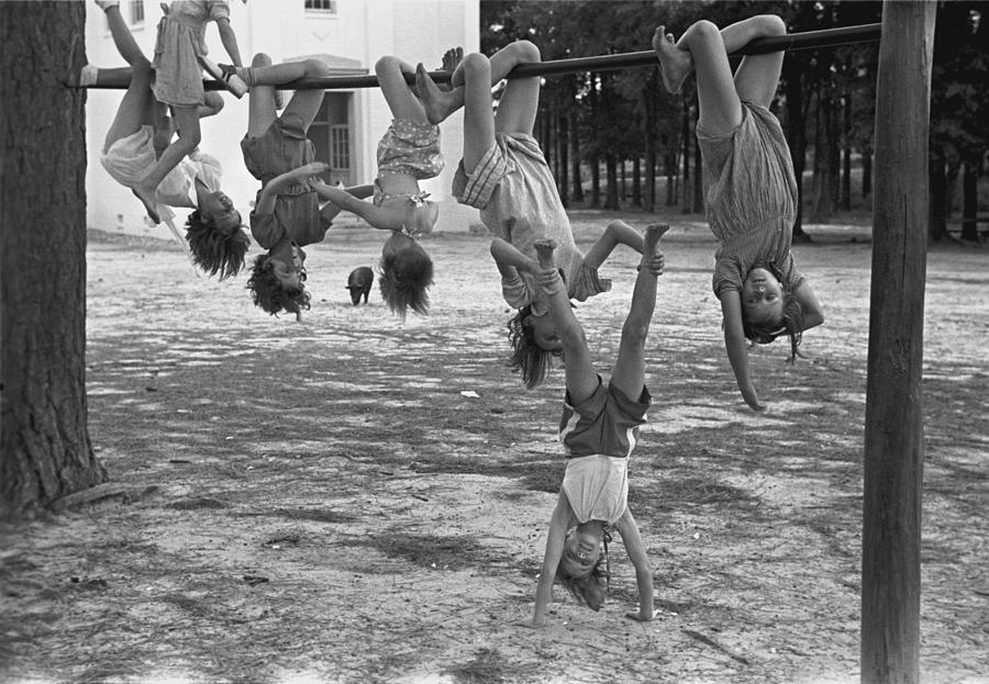 1930s Candid Photograph - Children Playing At A Playground by Everett
