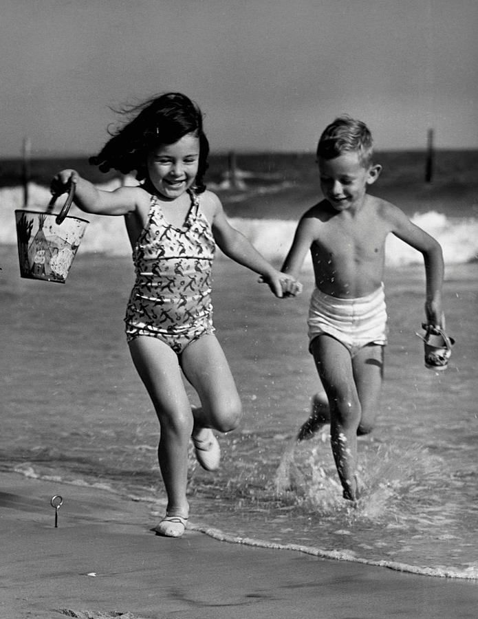 Child Photograph - Children Playing At Seashore by George Marks