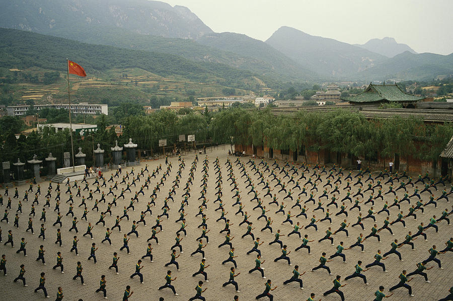 Asia Photograph - Children Practice Kung Fu by Justin Guariglia