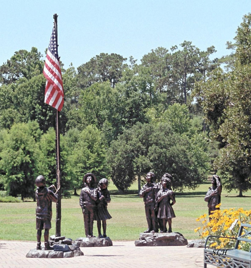 Statues Photograph - Children Raise The Flag by Lee Hartsell