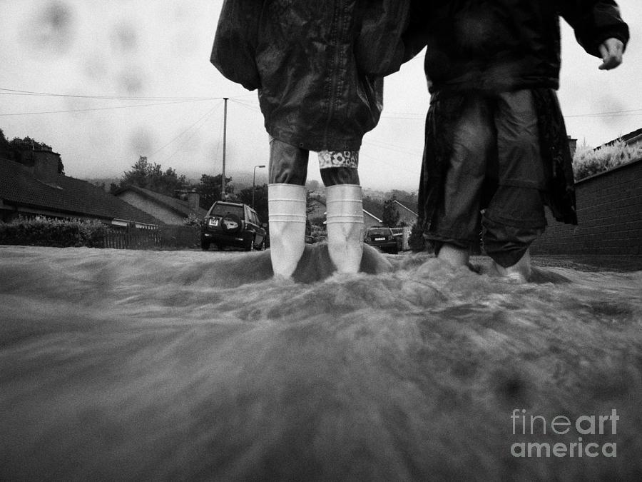 Rain Photograph - Children Walking In Heavy Rain Storm In The Street by Joe Fox