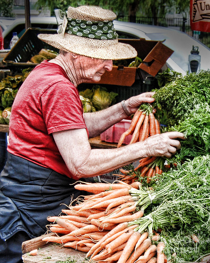 Choosing Photograph - Choosing Carrots by Norma Warden