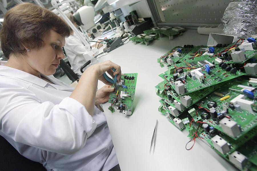 Electronic Circuit Photograph - Circuit Board Assembly Work by Ria Novosti
