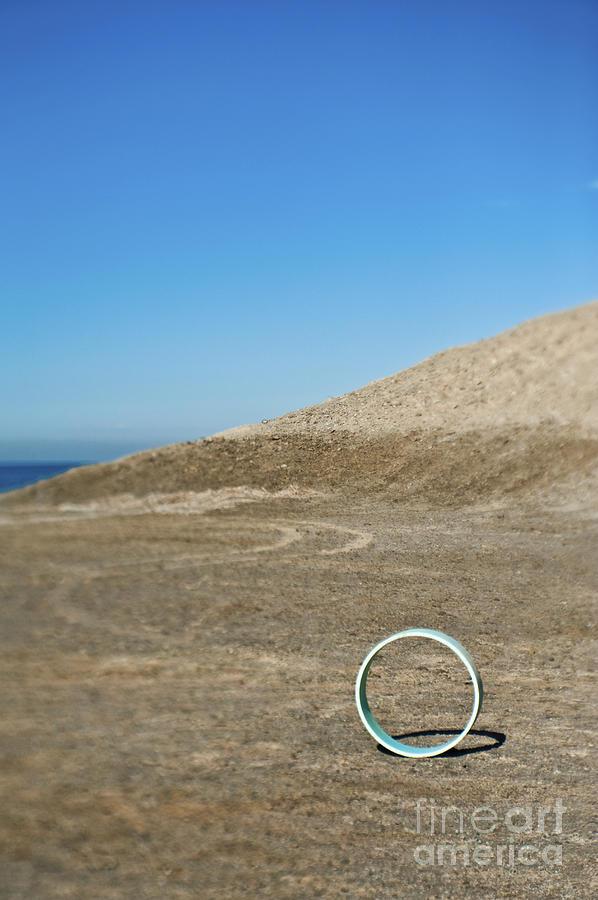 Abstract Photograph - Circular Object On Beach by Eddy Joaquim