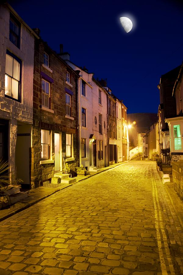 Cobblestone Photograph - City Street At Night, Staithes by John Short
