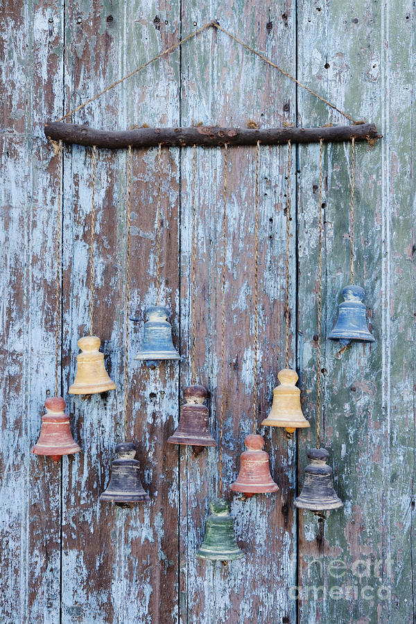 Artwork Photograph - Clay Bells On A Weathered Door by Jeremy Woodhouse