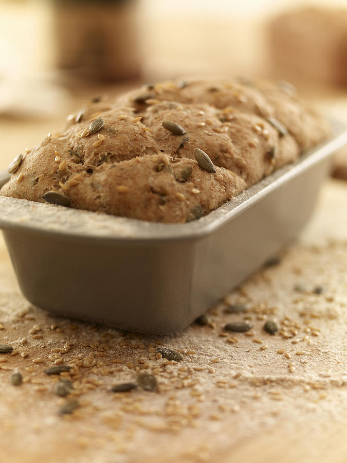 Vertical Photograph - Close Up Of Rustic Bread In Loaf Pan by Adam Gault