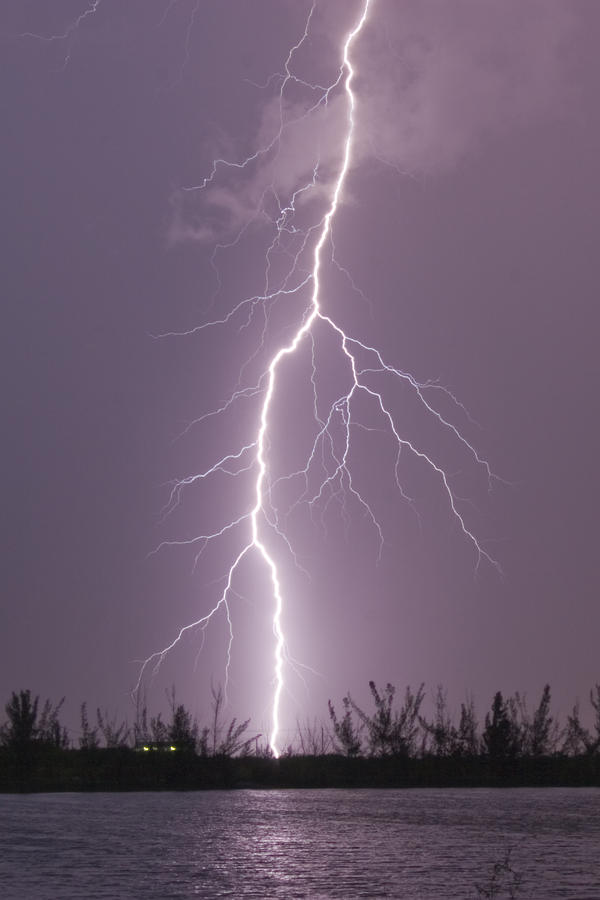 cloud to ground lightning strike photograph by mike theiss