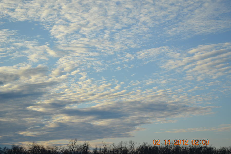 Clouds Photograph - Clouds Before A Storm by Heidi Frye