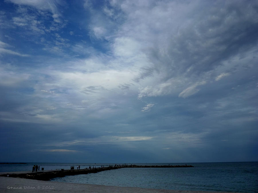 Sun Rays Photograph - Clouds Over The Jetty by Grace Dillon