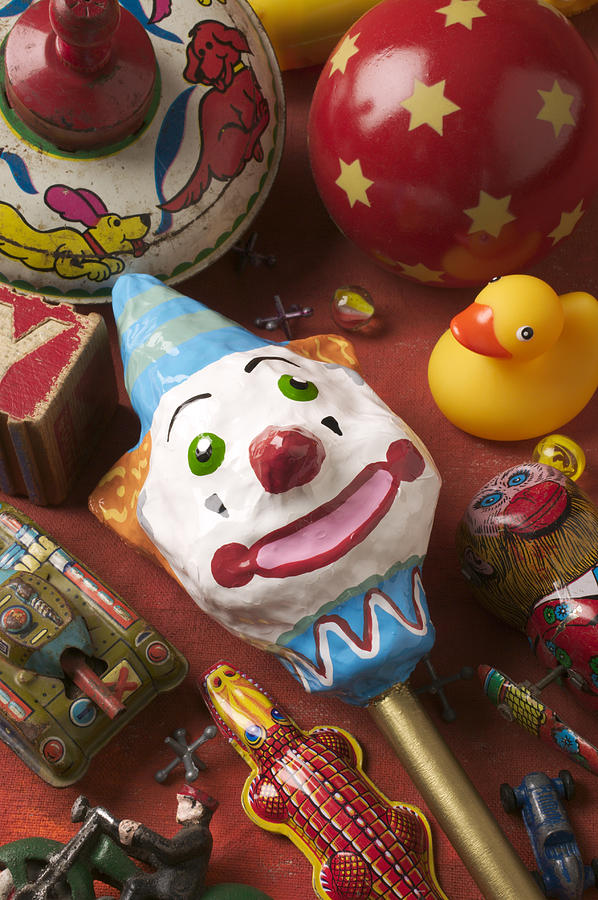 Toys Photograph - Clown Rattle And Old Toys by Garry Gay