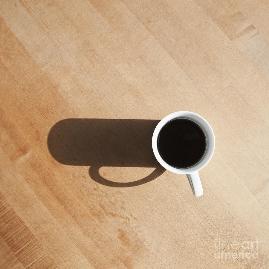 Coffee cup and shadow on a table photograph by jetta productions inc beverage photograph coffee cup and shadow on a table by jetta productions inc geotapseo Gallery