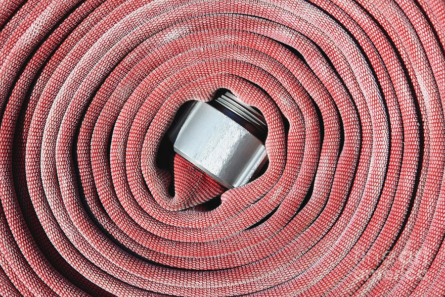 Close Up Photograph - Coiled Fire Hose by Skip Nall
