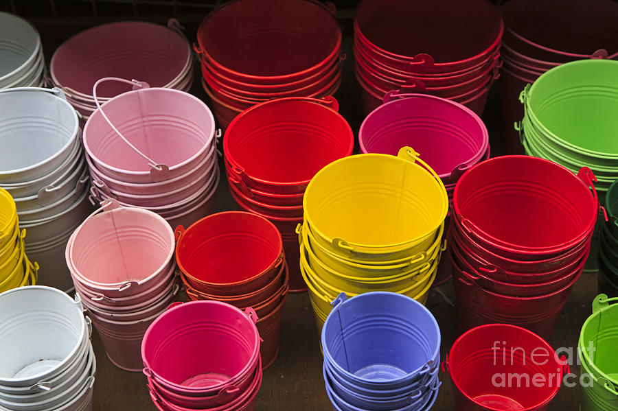 colors a display of colorful metal buckets photograph by louise