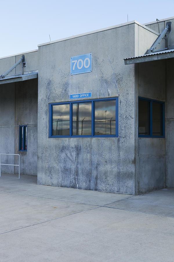 Surveillance Photograph - Concrete Building In A Prison Exercise by Roberto Westbrook