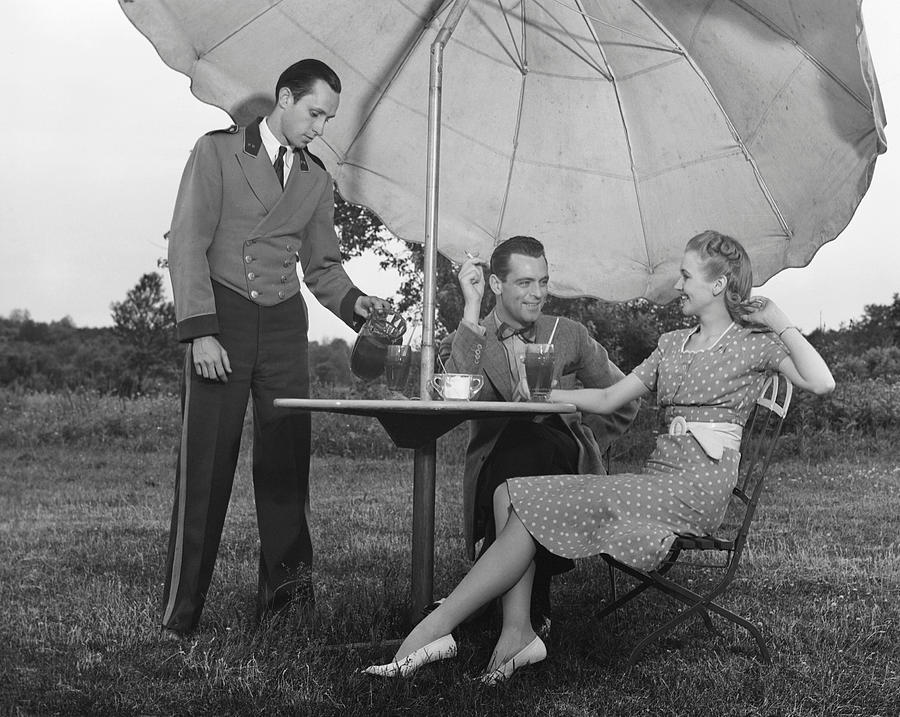 Adult Photograph - Couple Being Served By Waiter by George Marks