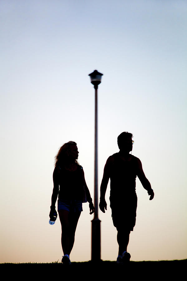 Adult Photograph - Couple Exercise While Walking At Sunset by Virginia Star
