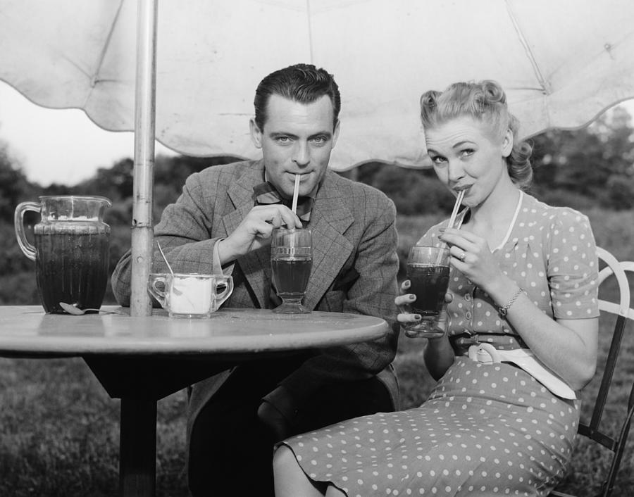 Adult Photograph - Couple Having Ice Tea Outdoors, (b&w), Portrait by George Marks