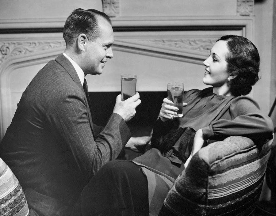 Adult Photograph - Couple On Couch Having Drinks by George Marks