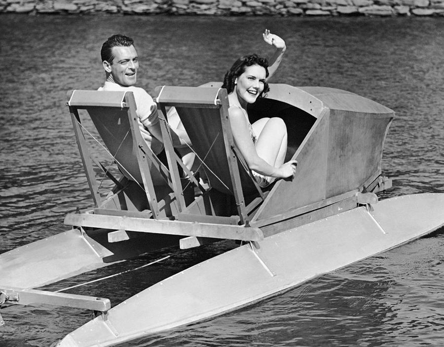 Adult Photograph - Couple On Lake In Paddle Boat by George Marks