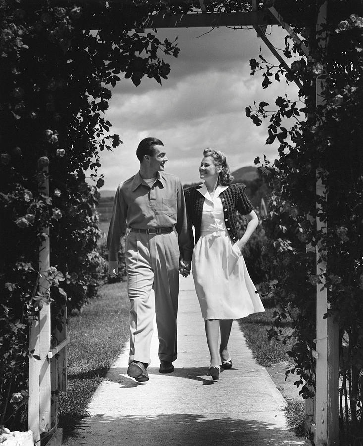 Adult Photograph - Couple Outdoors Holding Hands While Walking by George Marks