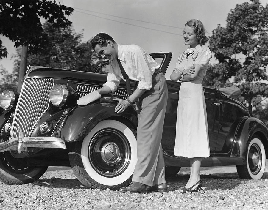 Adult Photograph - Couple Polishing Car by George Marks