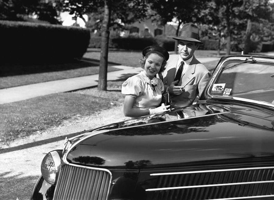 Adult Photograph - Couple Posing At Open Top Car, (b&w), Portrait by George Marks