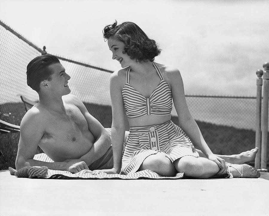 Adult Photograph - Couple Relaxing On A Sailboat by George Marks