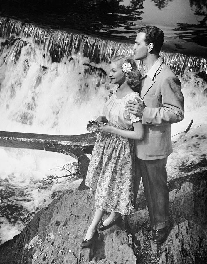 Adult Photograph - Couple Standing Near Waterfall by George Marks