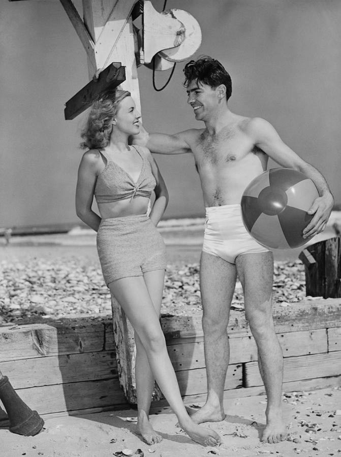 Adult Photograph - Couple Standing On Beach, Talking, (b&w) by George Marks