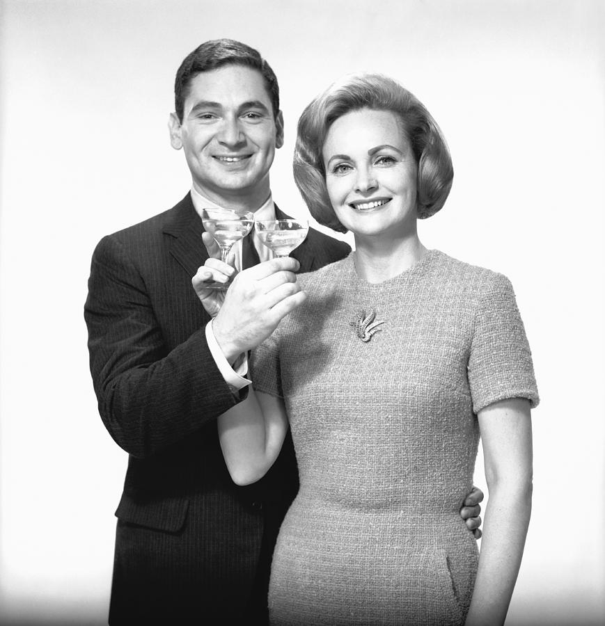 Adult Photograph - Couple Toasting Champagne In Studio, (b&w),, Portrait by George Marks