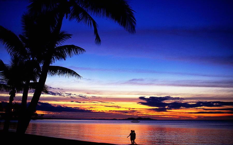 Adults Only Photograph - Couple Walking Along Beach At Sunset, Fiji by Peter Hendrie