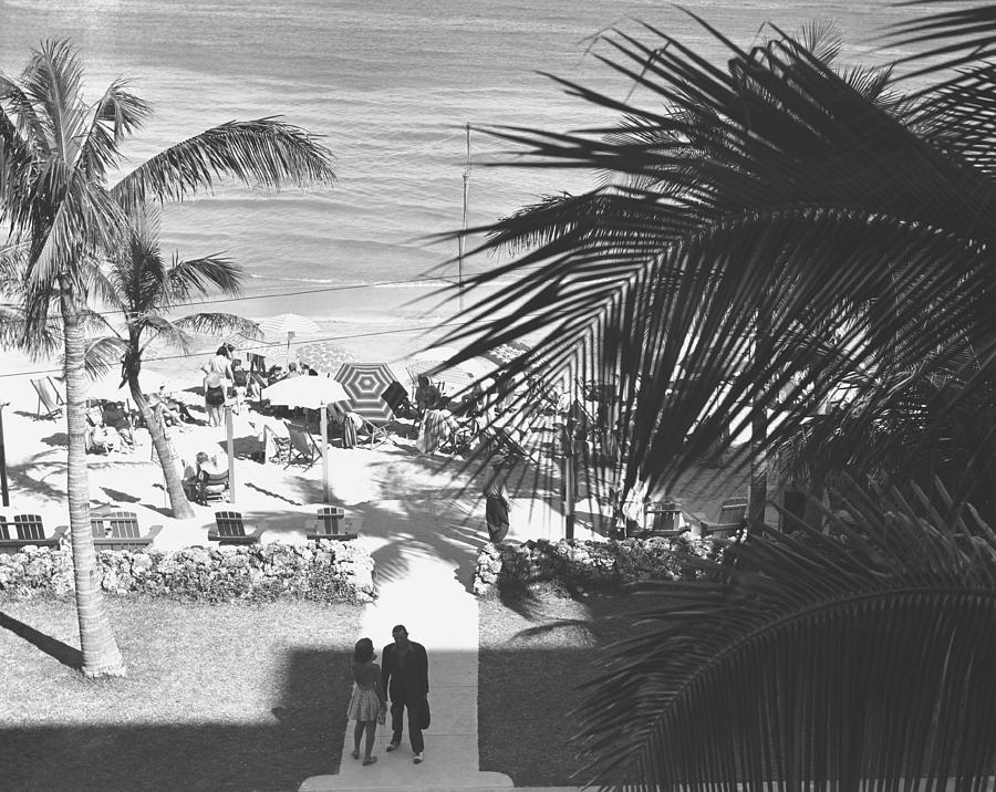 Adult Photograph - Couple Walking In Path Towards Beach, (b&w), Elevated View by George Marks
