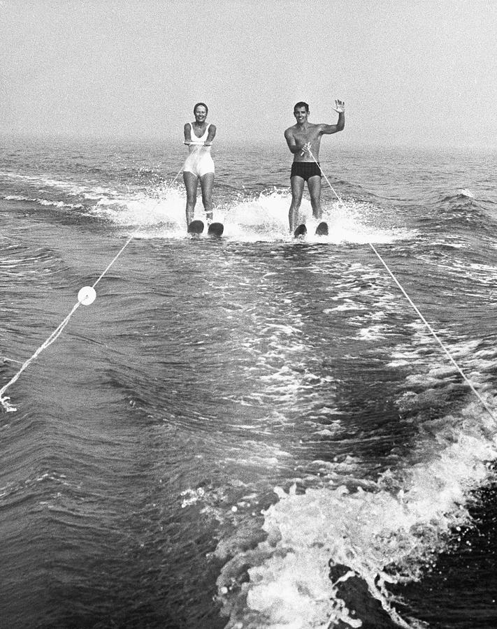 Adult Photograph - Couple Water Skiing by George Marks