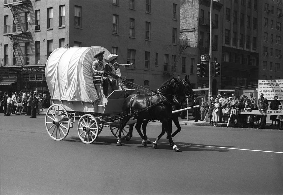 Horizontal Photograph - Covered Wagon On Street During Parade by George Marks