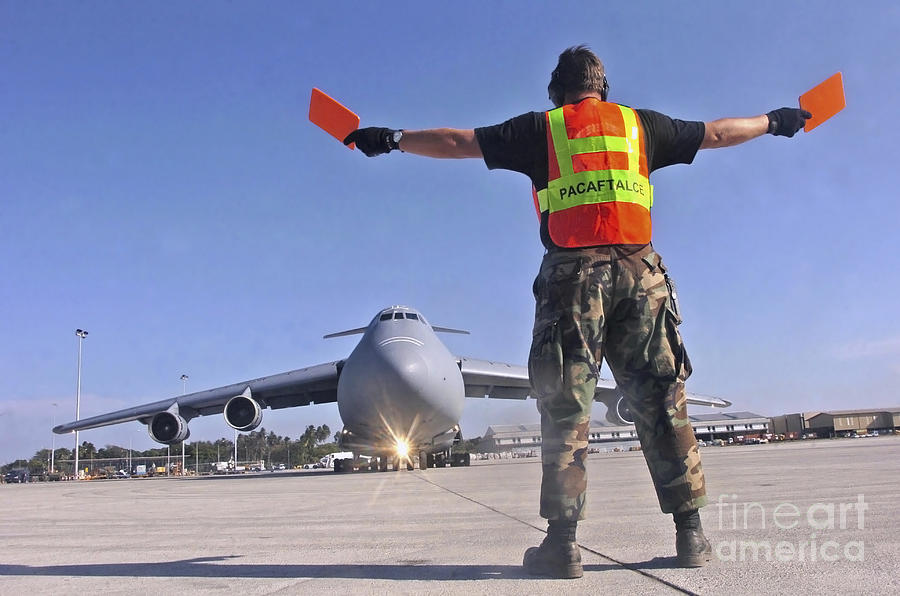 Color Image Photograph - Crew Chief Marshals A C-5 Galaxy by Stocktrek Images