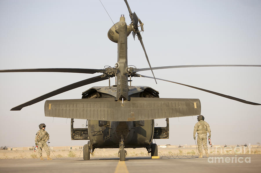 Aviation Photograph - Crew Chiefs Stand Beside Their Uh-60l by Terry Moore