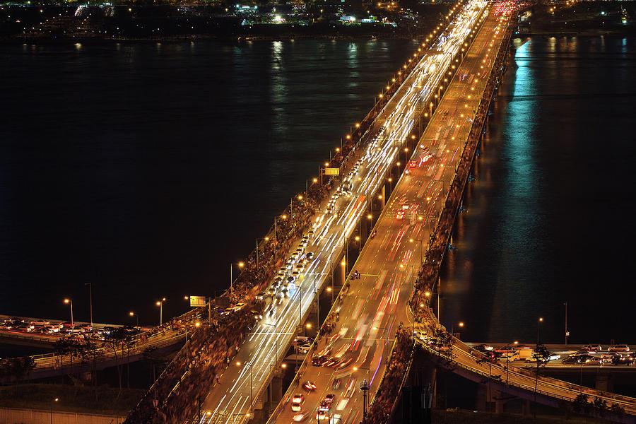 Horizontal Photograph - Crowded Bridge by SJ. Kim