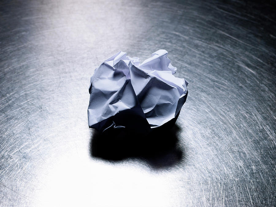 Horizontal Photograph - Crumpled Sheet Of White Paper On Stainless Steel. by Ballyscanlon