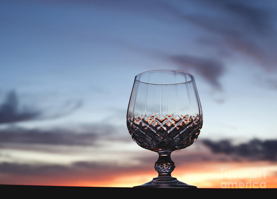 Cognac Photograph - Crystal Glass Against Sunset by Blink Images