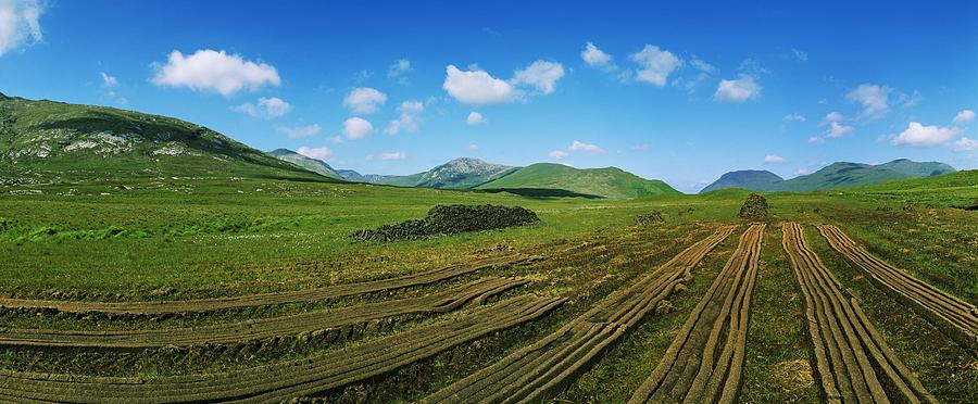European Union Photograph - Cut Turf On A Landscape, Connemara by The Irish Image Collection