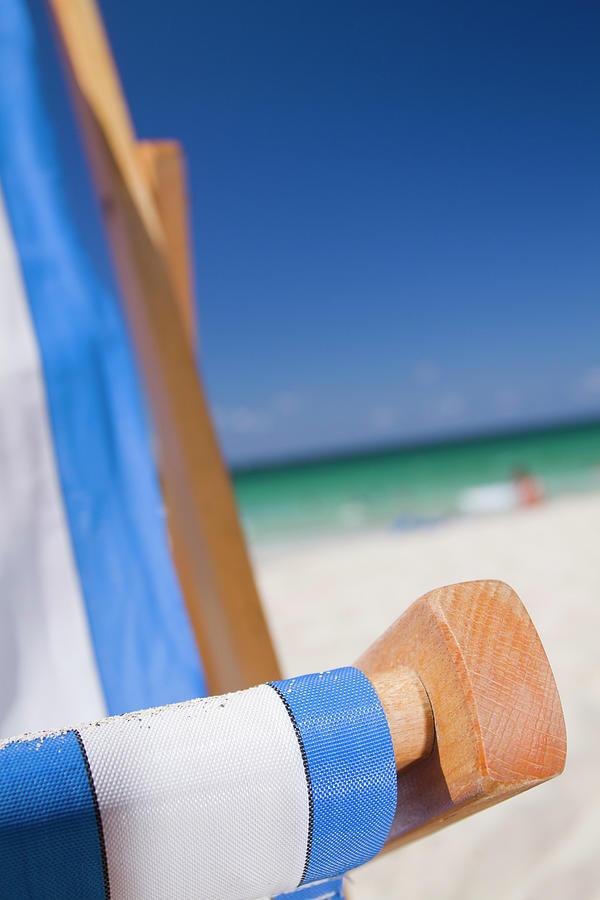 Vertical Photograph - Deckchair On Porthmeor Beach by Alex Bramwell