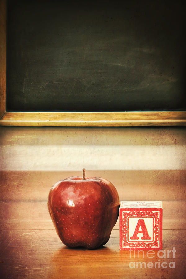 Delicious Red Apple On School Desk Photograph By Sandra