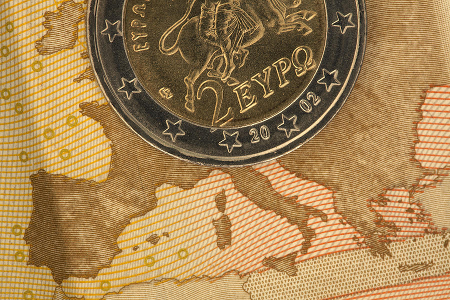 Detail Of A Fifty Euro Banknote With A Two Euro Coin On Top Of It Photograph by Larry Washburn