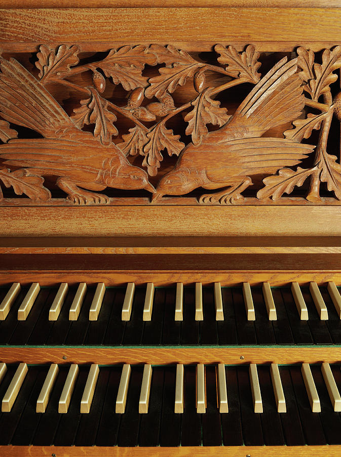 Vertical Photograph - Detail Of A Pipe Organ With A Wooden Carving by Gregor Hohenberg