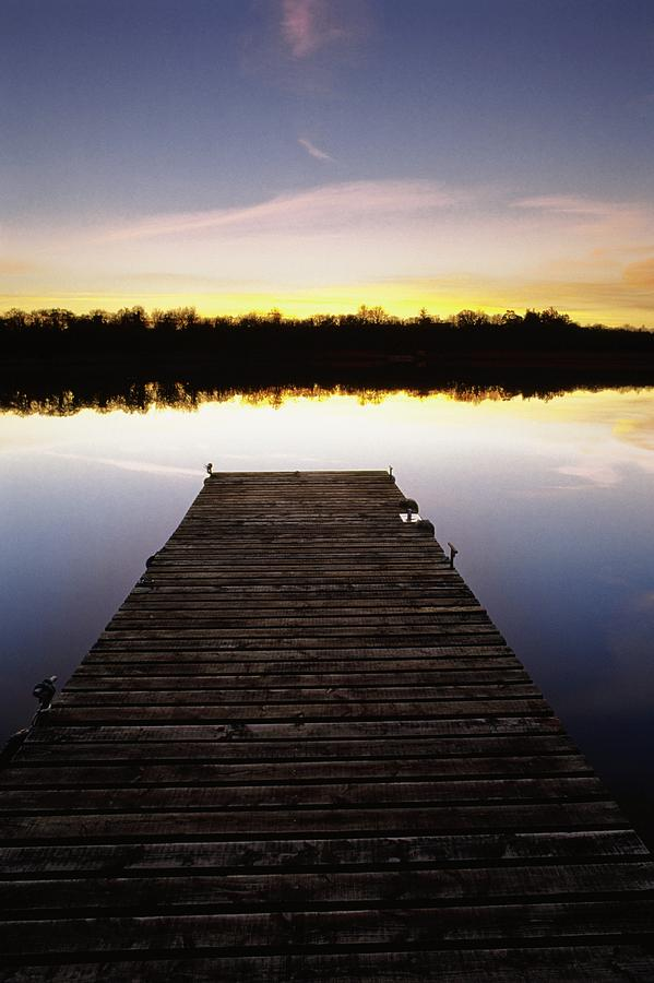 Sunset Photograph - Dock At Sunset by Gareth McCormack