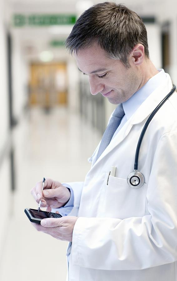 Telephone Photograph - Doctor Using A Smart Phone by