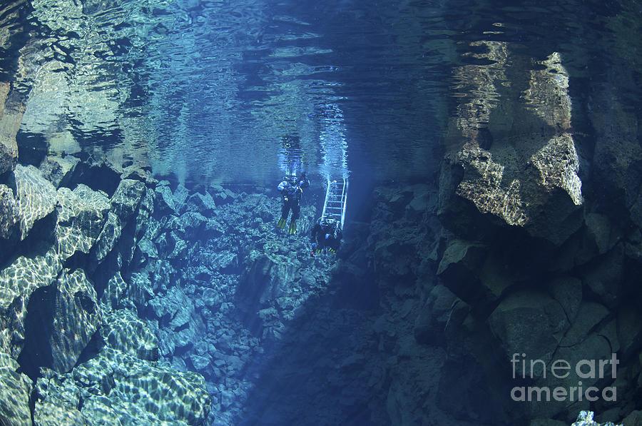 Diver Photograph - Dry Suit Divers Entering The Gin Clear by Mathieu Meur