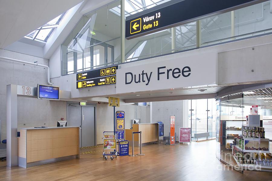 Air Travel Photograph - Duty Free Shop At An Airport by Jaak Nilson